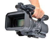 Videocamera in a hand — Stock Photo