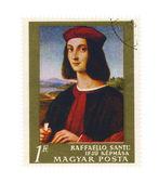 Una pintura sello raphaello santi - retrato de un hombre joven — Foto de Stock