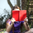 A child reading a book - outdoor — Stok fotoğraf