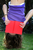 A child reading a book - upside down — Stock Photo