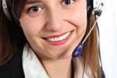 Smiling telephone operator — Stock Photo
