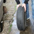 A car tire is changed — Stock Photo