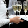 Waitress served champagner - Stock Photo