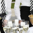 Two waiters fill glasses of champagne — 图库照片