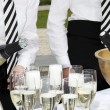 Two waiters fill glasses of champagne — Stock Photo