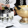 Stockfoto: Two waiters fill glasses of champagne