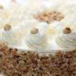 Cream cake with almond edge — Stock Photo