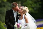 Bride and bridegroom - kissing — Stock Photo