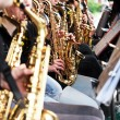 Many saxophone player in the orchestra — Stock Photo