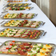 Buffet with appetizers or finger food — Stockfoto #3485312