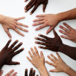 Many hands of persons of various nationalities — Stock Photo