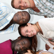 Foto Stock: Young from different backgrounds have fun together