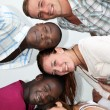 Foto de Stock  : Young from different backgrounds have fun together