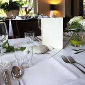 Menu card on an elegantly set table — Stock Photo