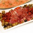 Ham, salami on a plate decorated with olives — Stock Photo