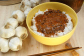Organic rice with mince meat sauce — Stock Photo