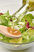 Olive oil to make fresh salad — Stock Photo
