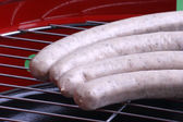 Sausage on a grill — Stock Photo