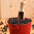 Stock Photo: Black pepper corn in red bucket