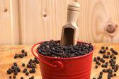 Black pepper corn in a red bucket — Stock Photo