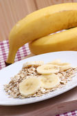 Breakfast with organic oatmeal — Stock Photo