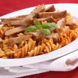 Noodle and organic pork goulash — Stock Photo
