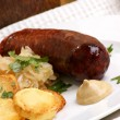 Stock Photo: Smoked sausage with organic sauerkraut and potato