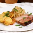 Stock Photo: Smoked pork with organic sauerkraut and potato