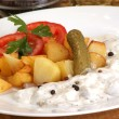 Roasted potato with herring on a white plate - Stock Photo