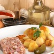 Roasted potato with cured meat in gelatine - Stock Photo