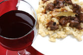 Home made red wine and organic deer goulash — Stock Photo