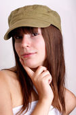 One young woman carries an farmers cap — Stock Photo