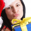 A young woman carries a christmas hat — Stock Photo #3730889