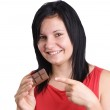 A young woman eating some home made chocolate — Stock Photo #3730931