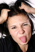 One aggressive young woman shows her tongue — Stock Photo
