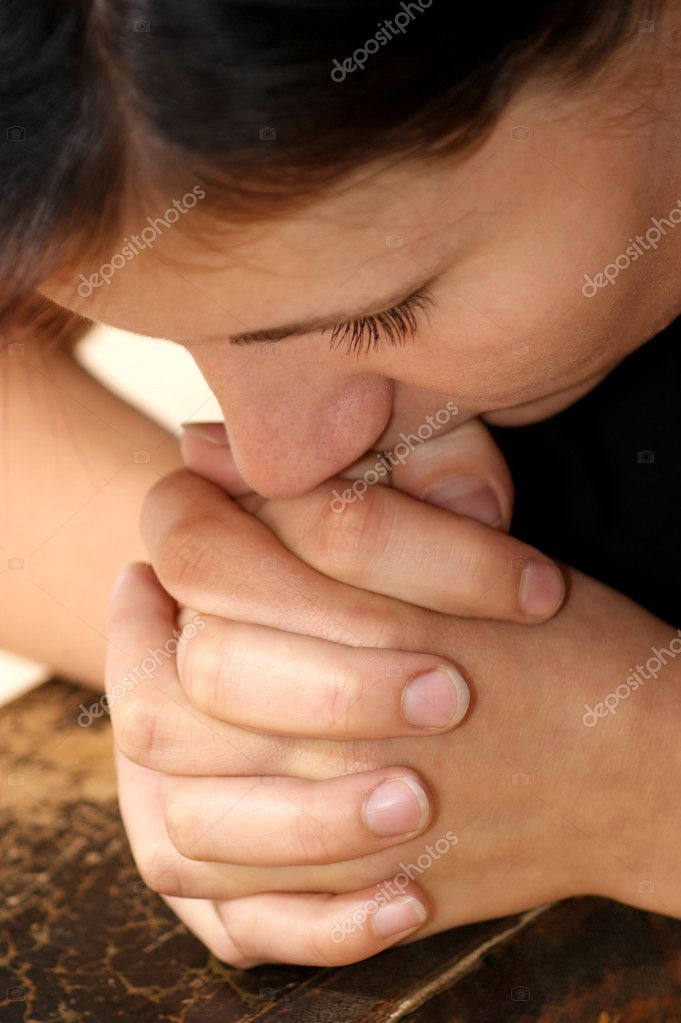 A young woman is praying in silence — Stock Photo #3745477