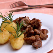 Stock Photo: Some grilled goulash and organic herbed potato