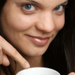 A young woman drinks organic black tea — Stock Photo #3868011
