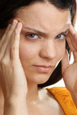 A young woman has a painfull headache — Stock Photo