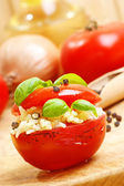 Organic grilled tomato with rice on a timber board — Stock Photo