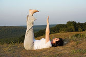 Woman concerns with yoga on sundown of the day.5. — Foto Stock