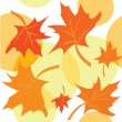 Seamless autumnal background with maple leaves — Imagen vectorial