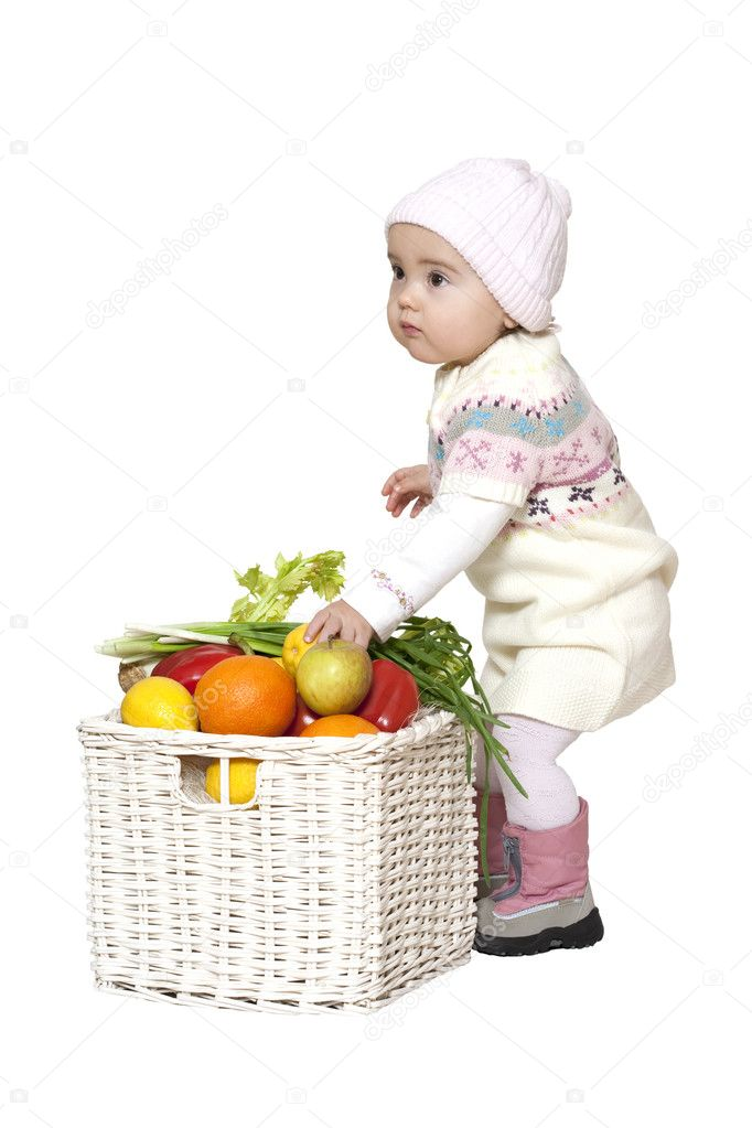 Toddler standing near fruit basket over white — Stock Photo #2746523