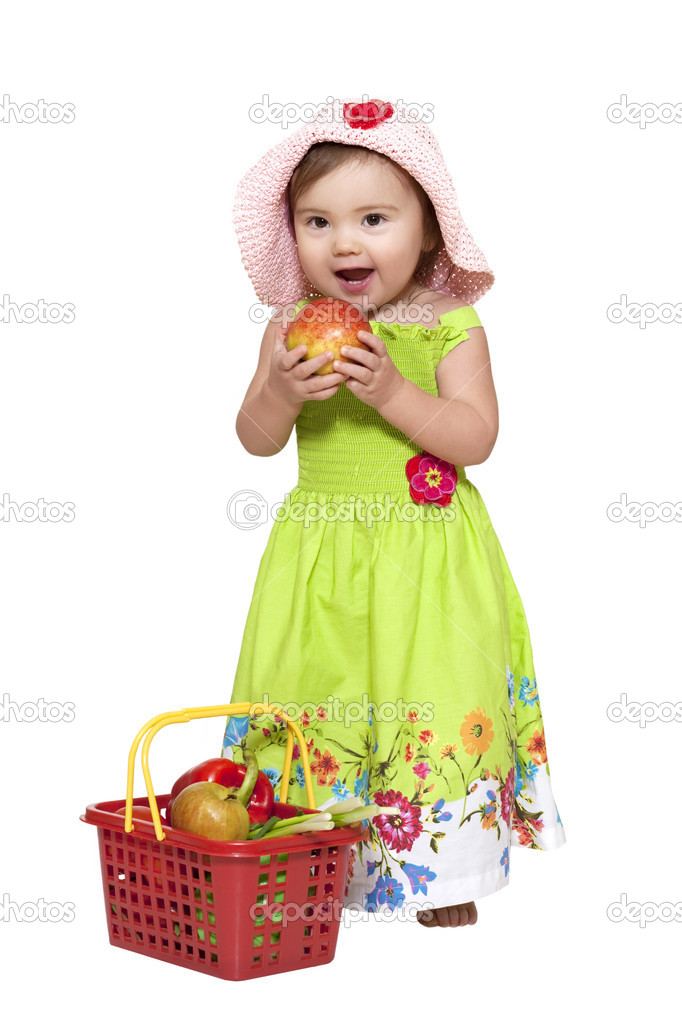 Toddler standing near fruit basket over white — Stock Photo #2803516
