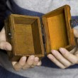 Hands holding a decorative wooden box — Stok fotoğraf