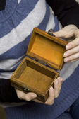 Hands holding a decorative wooden box — Stock Photo