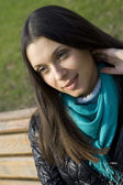 Beautiful girl in a park smiling — Stock Photo