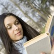 Young womin park reading — Stok Fotoğraf #2925746