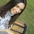 Stockfoto: Young womin park with book