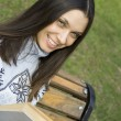 Young womin park with book — Stockfoto #2925770